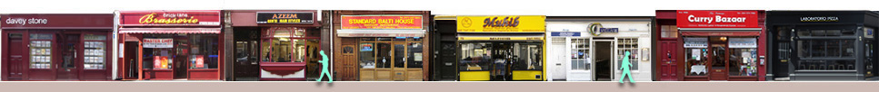 Panorama of shops and restaurants on London's Brick Lane 65 to 79