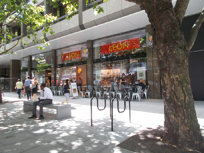 On Tottenham Court Road in London, Leon cafe with pavement seating