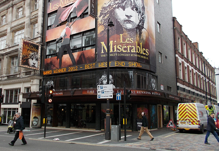 The Queens Theatre in London's with posters for Les Miserables