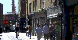 Brick Lane in London's Spitalfields with the old Truman brewery