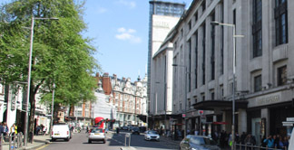 View down Kensington High Street in London with the famous Barkers building